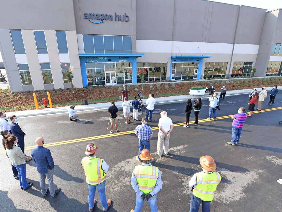 Attendees listen to Oakley Mayor Kevin Romick, during a ribbon-cutting at the new Amazon Fulfillment Center in Oakley on Oct. 7, 2020. The new 150,000 square foot center is expected to create about 800 jobs. Photo by Doug Duran, Bay Area News Group