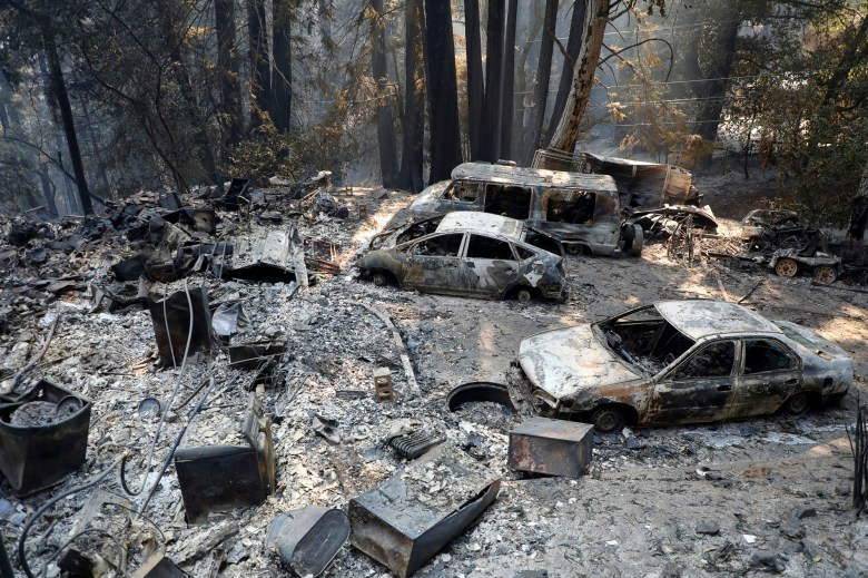 Burned cars are photographed at a home during the CZU Lightning Complex Fire on Sunday, Aug. 23, 2020, near Boulder Creek. Photo by Aric Crabb, Bay Area News Group
