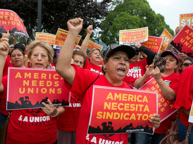 Josefina Pulido, center, cheers while holding a sign that read 'America needs unions' during a Service Employees International Union rally for higher wages at McDonald's in San Jose on September 4, 2017. Bay Area workers are joining the national 'Fight for $15' protest and are part of a nationwide union organized Labor Day action. Photo by LiPo Ching, Bay Area News Group