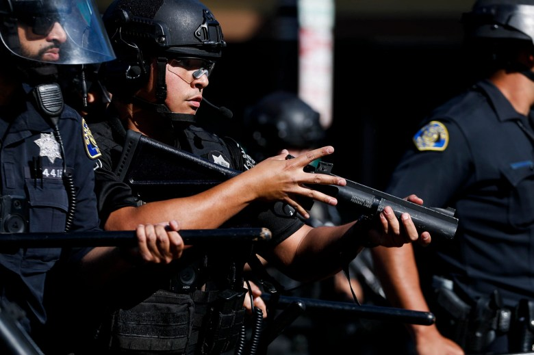 Police officers used rubber bullets to keep protesters back during a protest following the killing of George Floyd in downtown San Jose on May 29, 2020. Photo by Randy Vazquez, Bay Area News Group