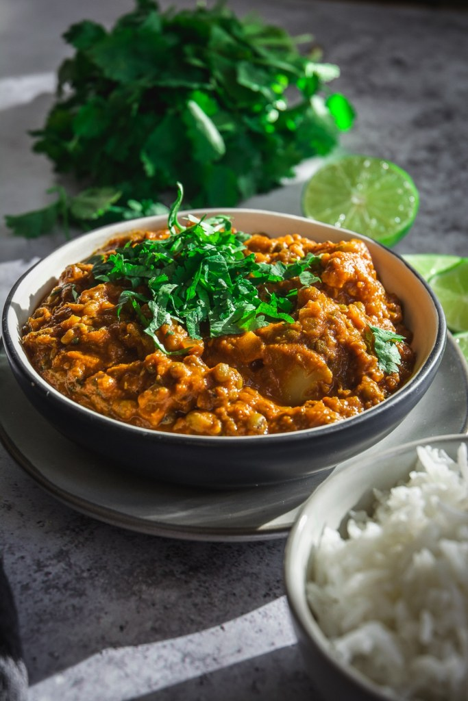 Easy and Healthy Cauliflower Mung Bean Curry on plate with lime and cilantro