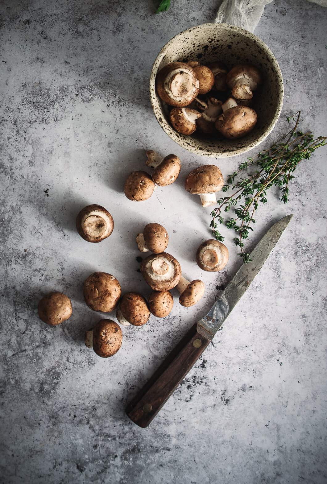 Mushrooms with knife, thyme and bowl