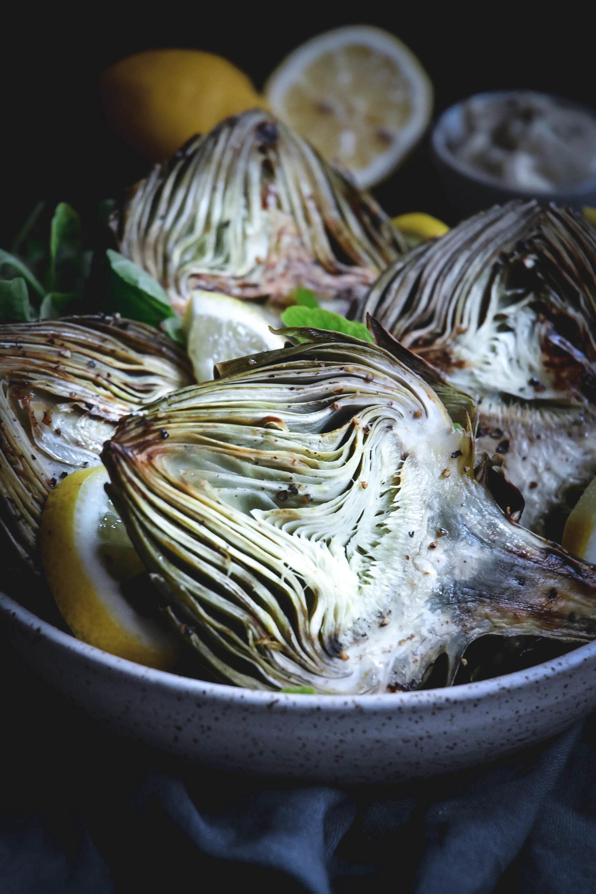 roasted artichoke halves in bowl