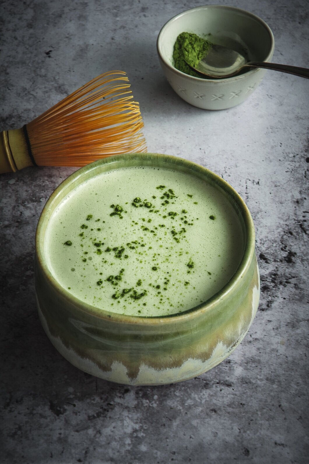 Matcha and moringa latte in cup