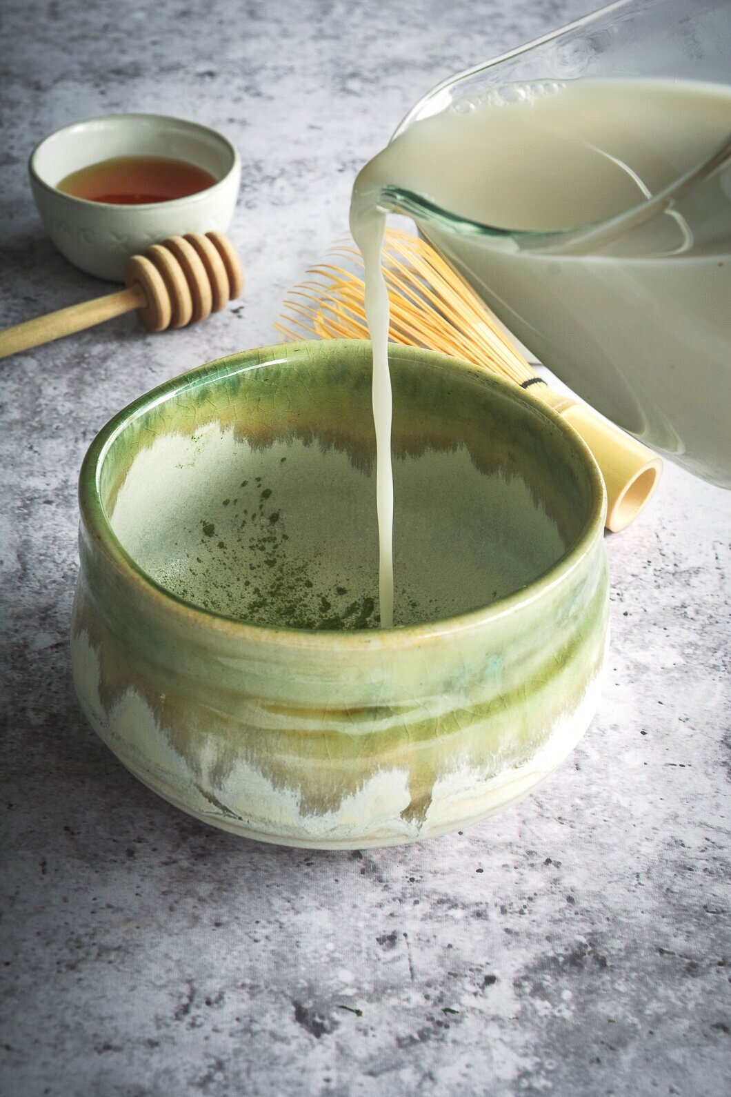 Pouring almond milk into mug