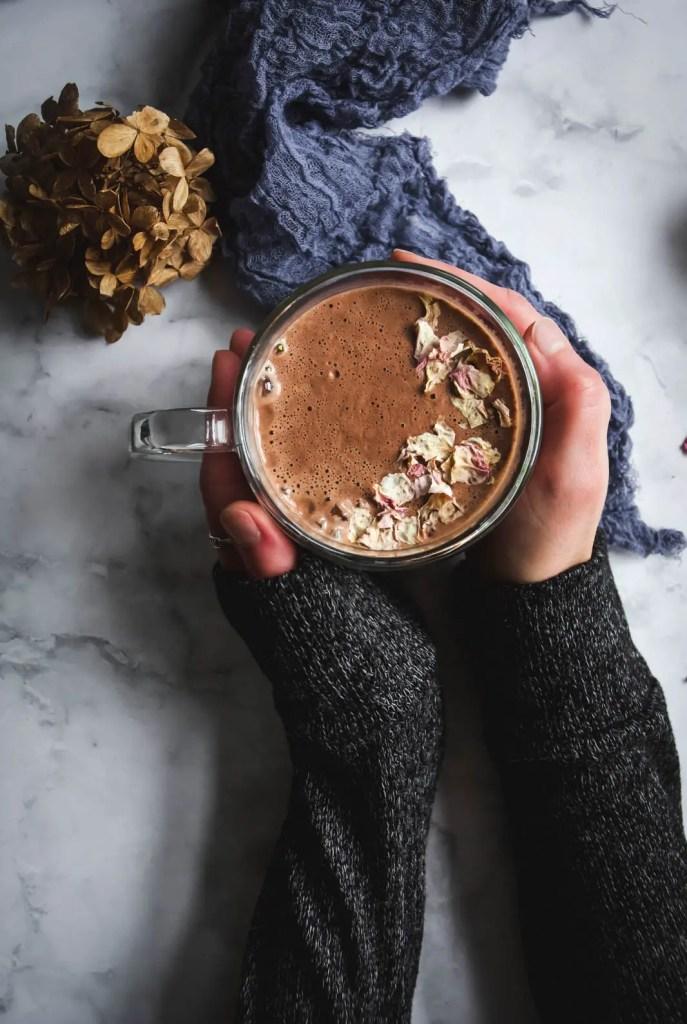 hot chocolate mug in hands