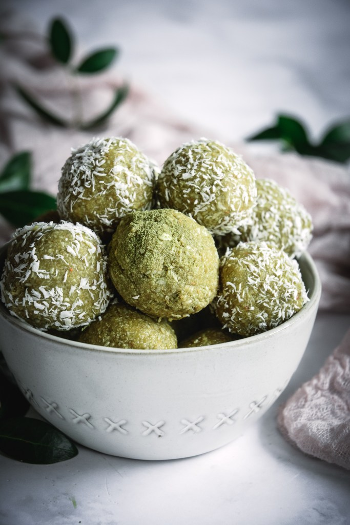 Coconut Cashew Matcha Honey Energy Bites in bowl