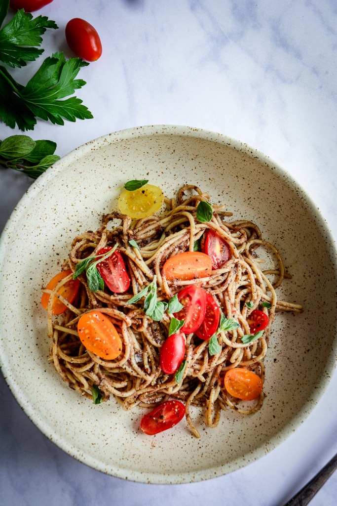 Moroccan Tapenade Spaghetti with Tomatoes and Herbs in bowl