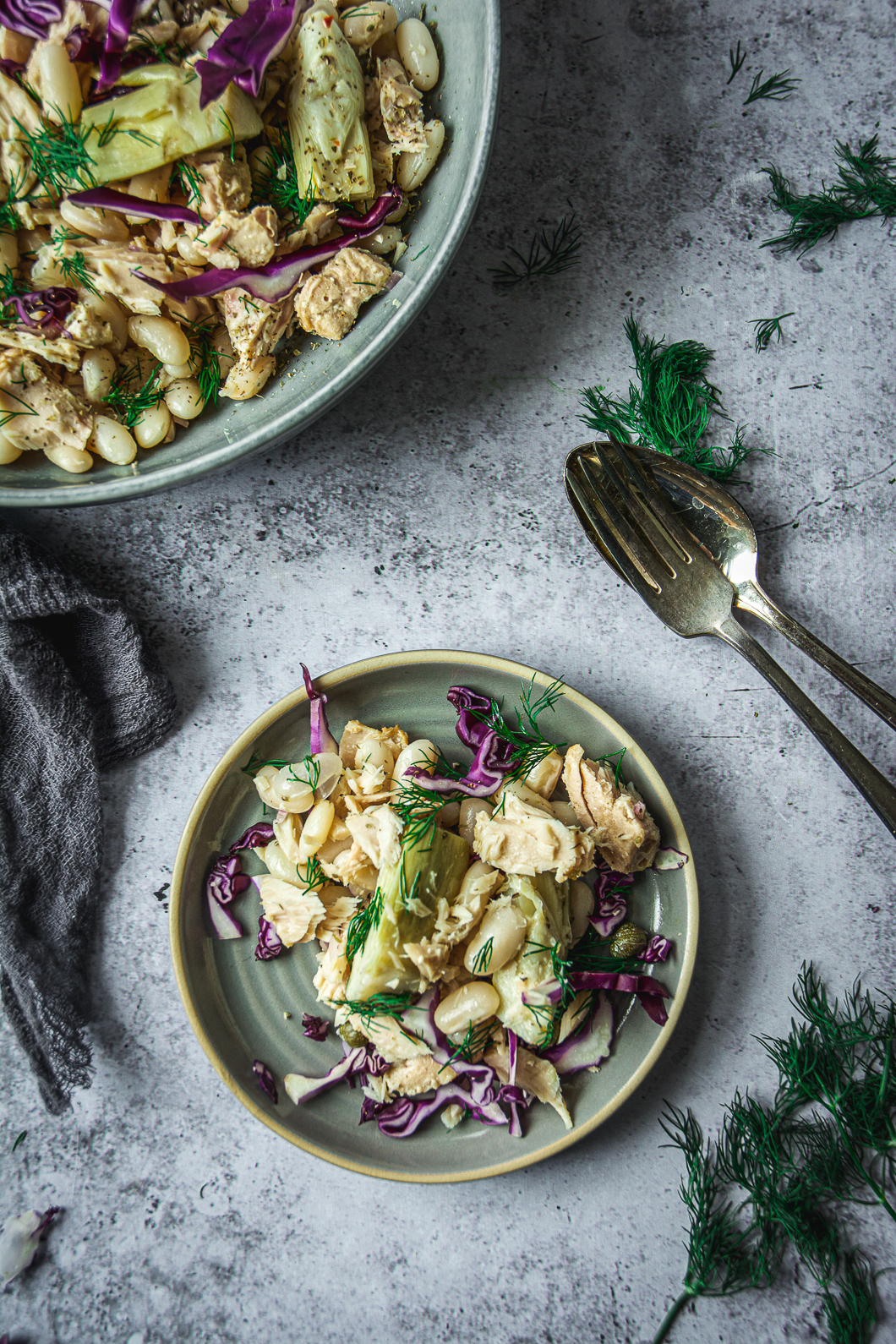 White Bean Tuna Salad with Artichoke Hearts in bowl and on small plate