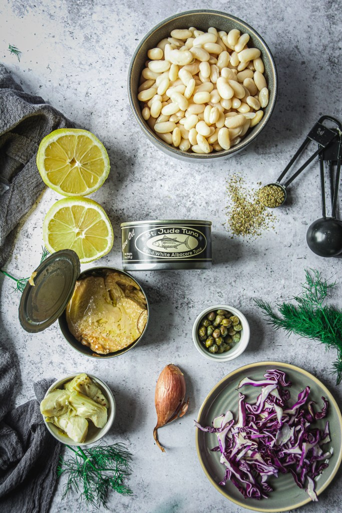 White Beans, artichokes, cans of tuna, lemons, sliced cabbage and dried oregano