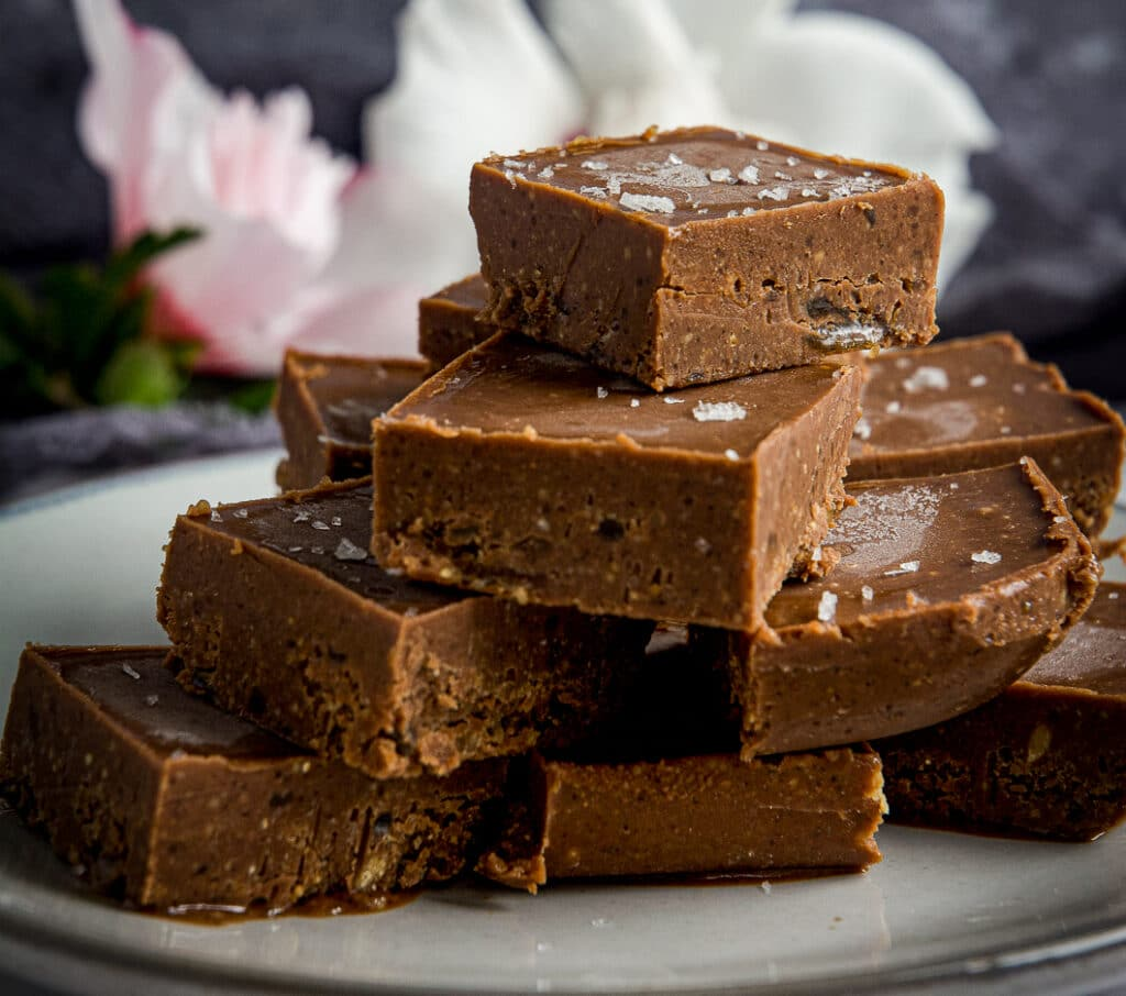 Vegan chocolate fudge on plate, sprinkled with salt