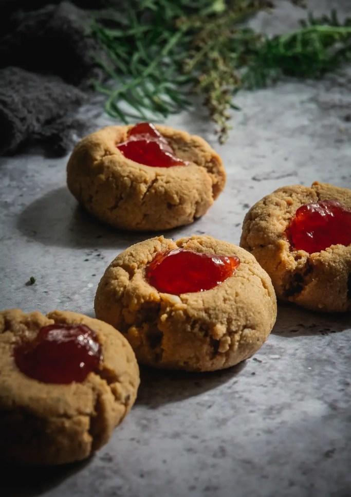 Almond Flour Cardamom Peanut Butter Thumbprint Cookies on table