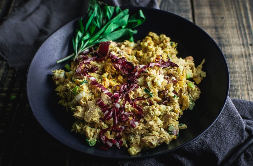 Quick Curried Tuna and Chickpea Salad with Tarragon in black bowl on napkin