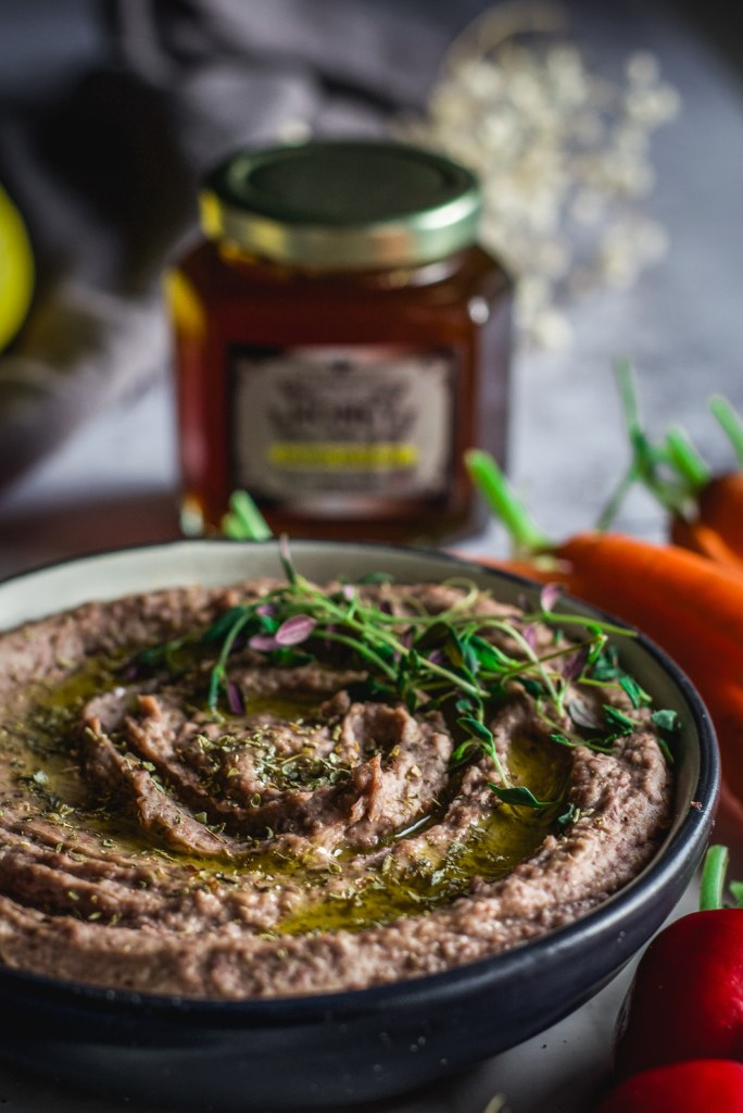 adzuki bean hummus with carrots and thyme in background