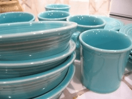 Image shows turquoise stoneware dishes that are perfect for serving two-minute yoghurt, the recipe for which is given on this recipe page of CALMERme.com