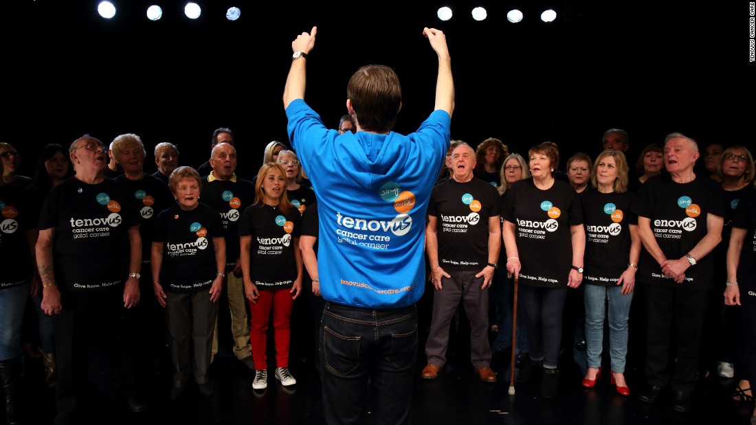 Image showing the Tenovus choir singing together wearing matching t-shirts