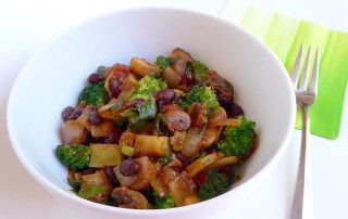 Image shows a white bowl full of colorful cooked vegetables (including some cruciferous vegetables) in this one-pot-meal recipe as described on CALMERme.com
