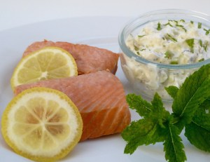 Image shows salmon fillets that have been poached in herbal tea, as described in this recipe on CALMERme.com