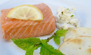 Image shows salmon fillet that has been poached in herbal tea, as described in this recipe on CALMERme.com