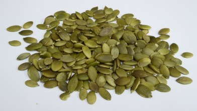 Image shows raw pumpkin seeds prior to being made into magnesium rich pumpkin seed butter, as described in this post on CALMERme.com