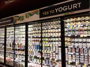Image shows a yogurt case in a grocery store, as described in this post on CALMERme.com