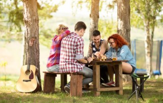 Image of group playing games in the woods to depict Hygge from CALMERme.com