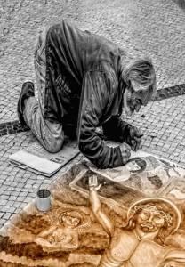 Pintor callejero pintando a Jesús
