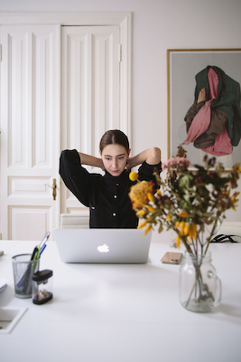 Woman stressed in front of her computer. Generalized anxiety can often be about money, relationships, health, and one's job.