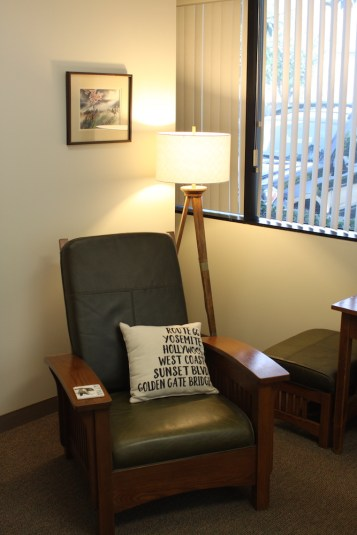 Chair in an office with a lamp and painting behind. The California OCD and Anxiety Treatment Center is able help you reach your treatment goals using evidenced based treatments.