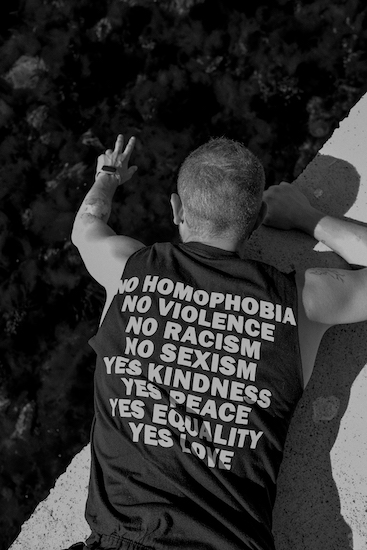 Man wearing a shirt denouncing homophobia. Being supportive of the LGBTQ+ community does not make you gay, no matter what HOCD says.