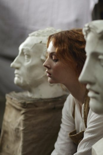 Woman sitting deep in thought between two marble statues. Thought Action Fusion can cause sufferers to mistake thoughts for reality. Contact CalOCD for OCD treatment in Southern California or online therapy in California or Montana.
