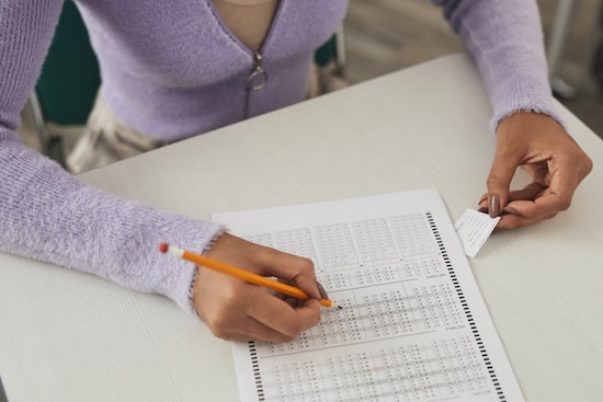 Woman cheating on a test. Real-Event OCD