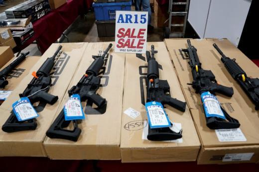 AR-15 rifles are displayed for sale at the Guntoberfest gun show in Oaks, Pennsylvania