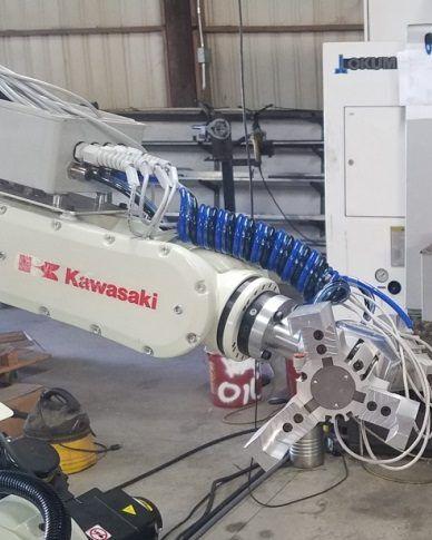KAWASAKI MACHINE TENDING ROBOT WITH TOOLING