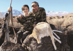 Author with his daughter and her shot coyote.