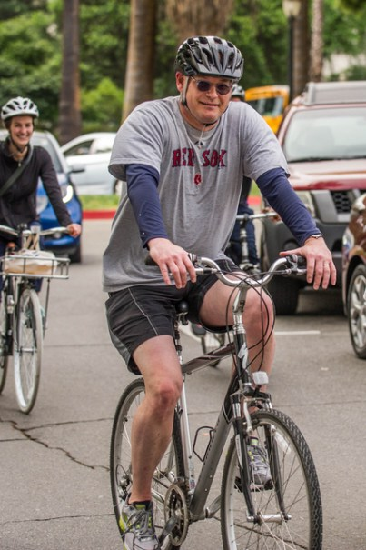 CalSTA Secretary Brian Kelly takes a lap around the Capitol Street roundabout after riding his bicycle to work.