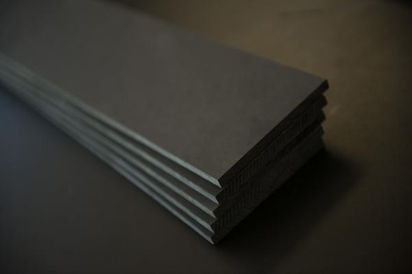 Resined paper composite material