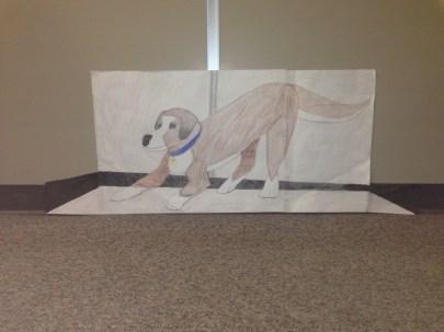 A dog in the art hallway.