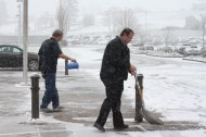 Administrators and maintenance workers clear the walkways.