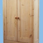 Traditionally designed wardrobe finished with a specialized old pine stain for an aged appearance.