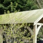 Carport made from air-dried oak and decking for the roof