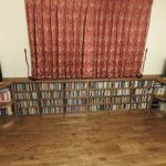 Made-to-measure CD storage in walnut with rounded end units
