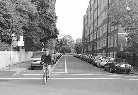The city's own picture of this scene shows a cyclist happily steering straight toward a curb.