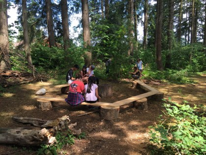 Students work on their soapstone carving reflections in the outdoor classroom