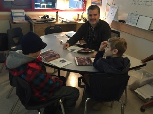 Mr. Fleming works reading with students.
