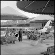 Beach patrol plane at Floreat Forum Shopping Centre, 1967. [Battye Library ref: BA1119/3030, 345814PD.] The plane was used for shark spotting and 6KY radio station featured live broadcasts from the plane on weekend afternoons. It was on display at Floreat Forum to promote the beach patrols which began on 16 Dec 1967. Shops in background include Walshs, Chalet Coffee Lounge and heritage.