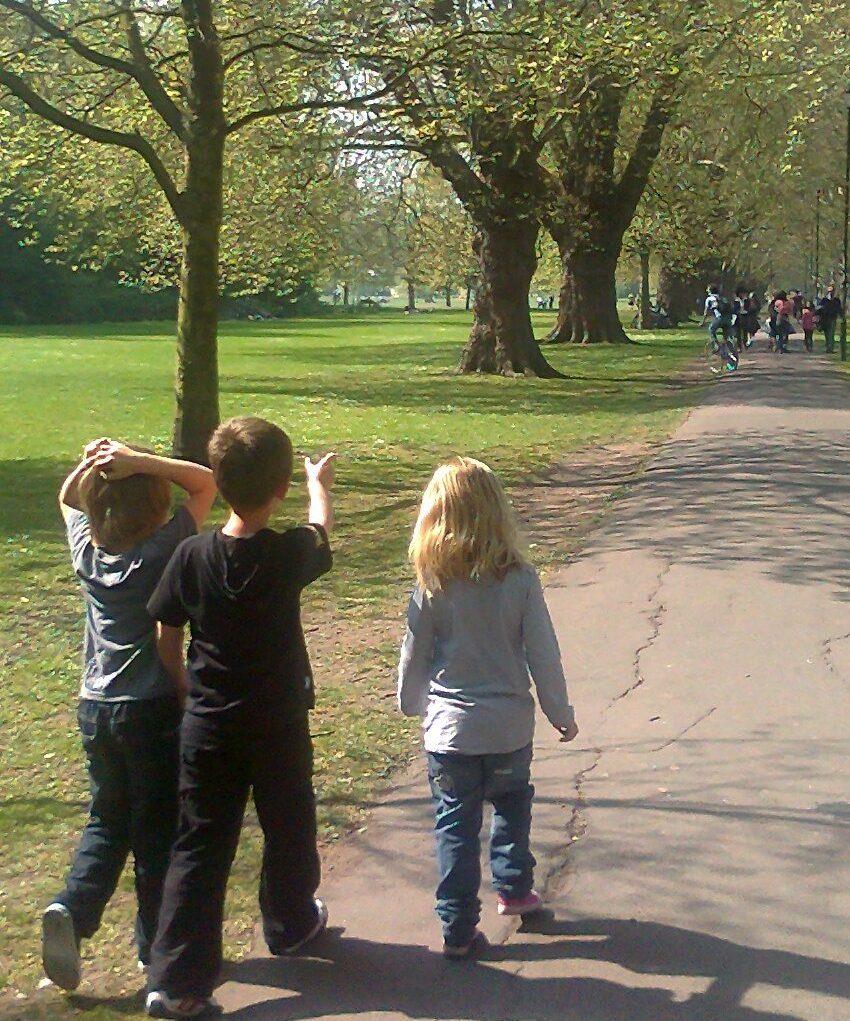 Three children walking on Jesus Green