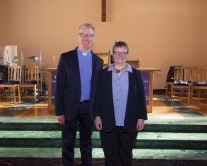 Rev Peter Nimmo and His Wife Caterina stand on the Chancel Steps