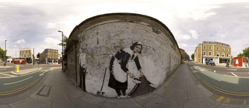The Chambermaid stencil on the wall of the Roundhouse in Camden - Banksy 2006