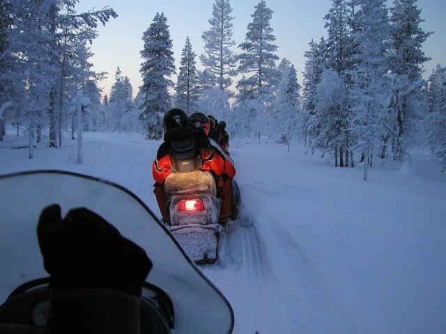 Driving a snowmobile in Saariselkä, Lapland